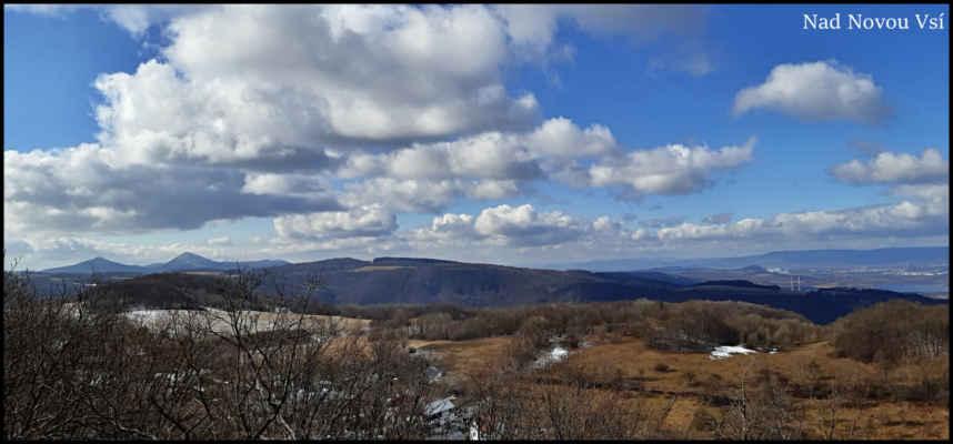Středohoří - Pohled k Milešovce a Kletečné,vlevo ještě čerstvý sníh na Vidrholci,který dlouho jarnímu Slunci neodolá..